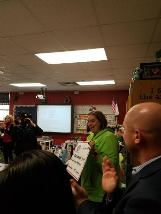 Mrs. Salvagnini receives a check from the Education Foundation representatives
